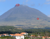 Picture of Pico Mountain with location of the mountaintop observatory (top red circle) and of the visitor center (lower circle).